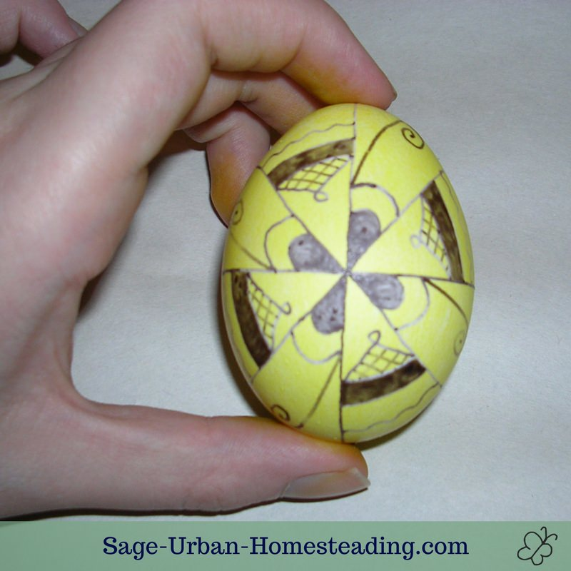 yellow egg with wax decoration