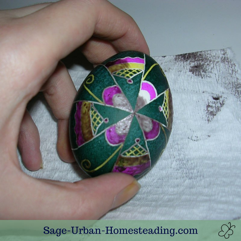 egg with wax melting to reveal multiple colors