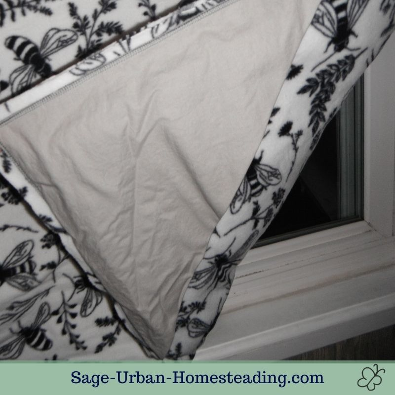 how to hang a window quilt with pockets