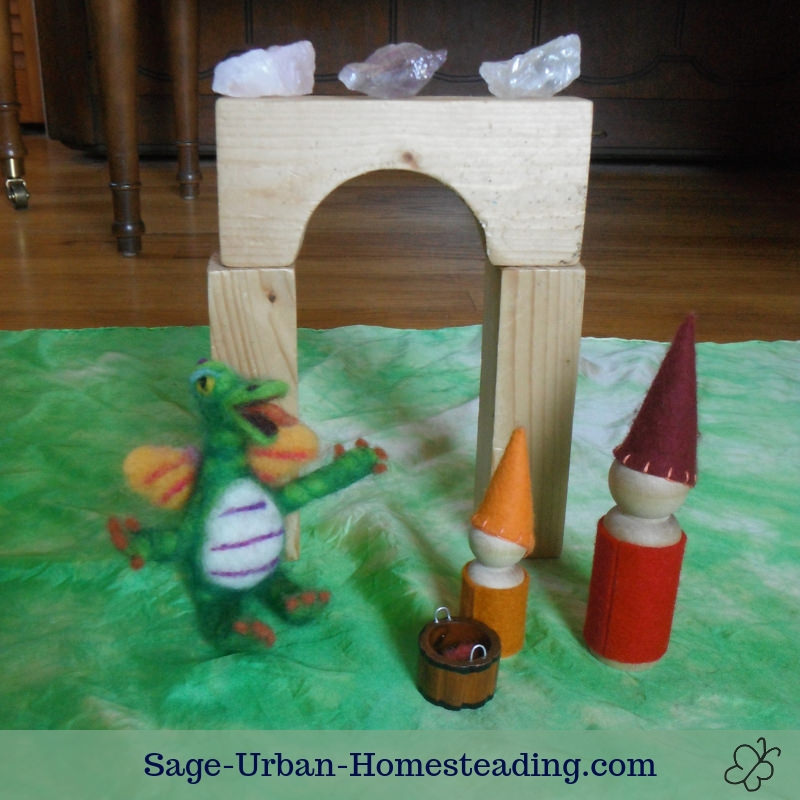 Waldorf Essentials K2 October week 1 story scene, offering apples to the dragon
