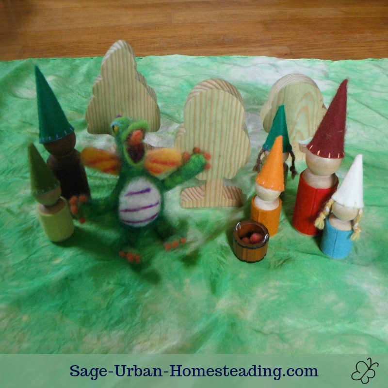 Waldorf Essentials K2 October week 2 story scene, gnomes harvesting apples with a dragon