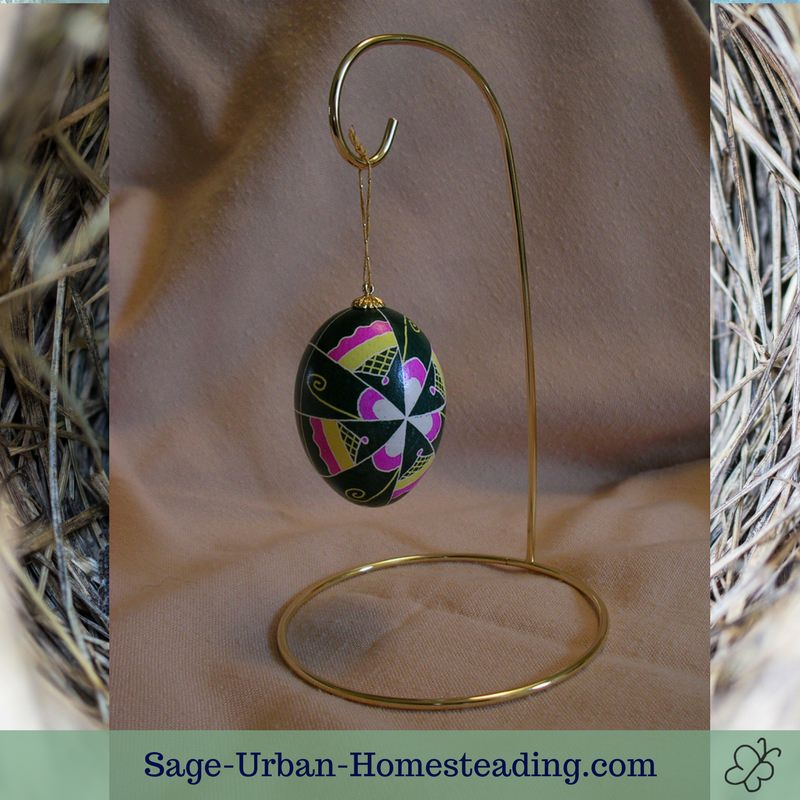 egg ornament hanging on display stand